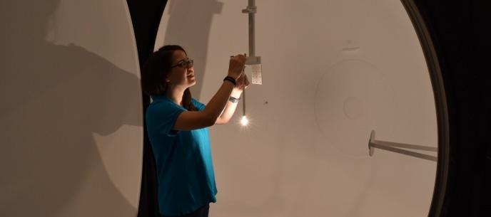 elite employee performing photometrics test